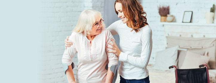 adult woman together with her caregiver