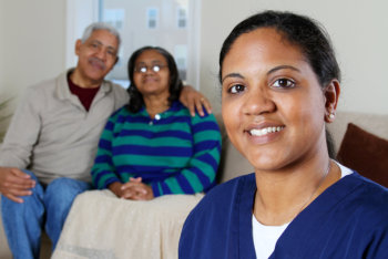 health care worker and an elderly couple