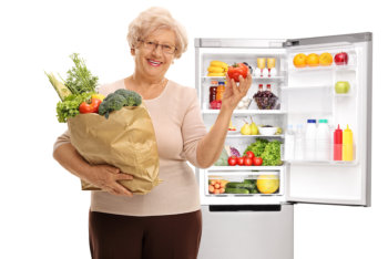 elderly woman holding groceries